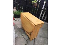 Fold away solid wood table and 4 chairs in very good condition