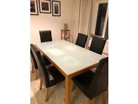 Dining table with storage unit and chairs