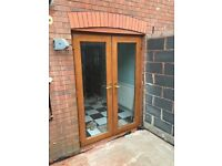 Brown double glazed French doors, 5 yrs old in very good condition. Genuine bargain.