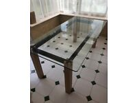 Glass top Habitat dining table with solid oak legs