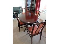 Stag Minstrel Oval extending dining table and 4 chairs