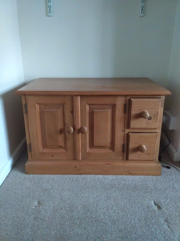 Pine cabinet with drawers and doors
