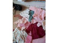 Bundle of newborn baby girl clothes