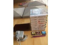 Nintendo DS XL,console,(in plum),stylus pen,charger and 11 games.