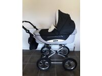 Navy & cream Special Edition Babystyle pram/pushchair with lots of accessories.