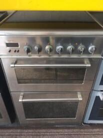 Stainless steel delonghi 60cm ceramic hub electric cooker grill & fan assisted ovens with guarantee