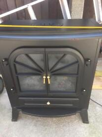 Large stove electric fan heater black 60cm wide 36cm front to back 66cm high, has side handles