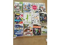 Nintendo Wii console + Wii fat balance board + lots of games