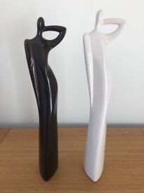 A pair of people shaped ornaments - excellent condition