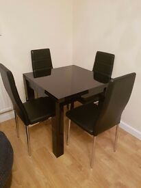 Dining Table from Next - Black extendable, square to Rectangle