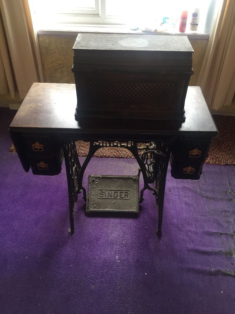 Vintage Singer sewing machine and cabinet