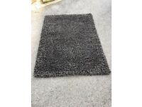Stylish black shaggy rug, hand tufted with mixed acrylic 170cm x 120cm