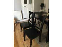Four elegant black dining chairs from Ikea