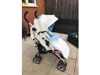 White and baby blue leatherette pushchair