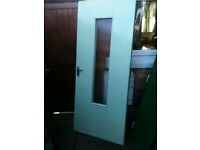 Exterior wooden door with ribbed glass
