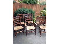 6 antique/vintage dark oak rush seated dining chairs including 2 carvers
