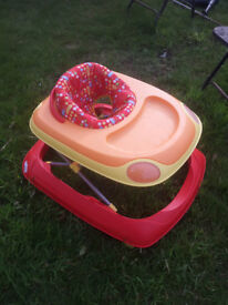 Car shaped Baby Walker. Red and yellow. Adustable height.