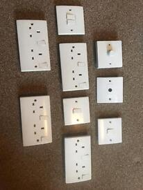 Assorted white sockets & switches