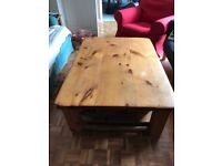 Large solid pine coffee table with a bottom shelf and storage baskets. . 122cm x 89.5cm
