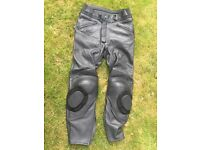 LEATHERS (UNUSED) - MOTORBIKING TROUSERS (BLACK) Manufactured by TRIUMPH