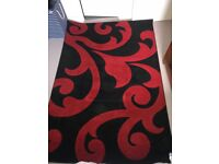 Black and red swirl rug