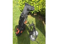 Golf clubs and bag and carrier