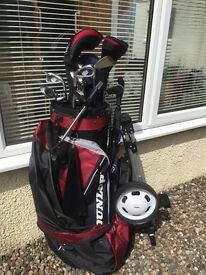 Nearly new Set of Dunlop clubs inc. 3 fibre glass woods, 9 clubs, 1 putter, bag & trolley