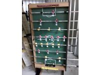 Large football table, stands up as picture shows for easy storage