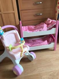 Dolls bunk beds with doll and pushchair