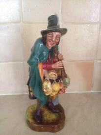 A rare figurine of The mask seller by Royal Doulton HN2103