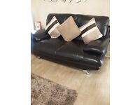 Ex Harvey's black leather suite 3+2+1 in very good condition