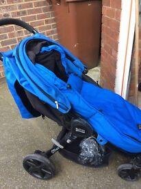 Blue pushchair