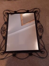 Black metal framed mirror.