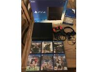 PS4 500GB boxed 2 pads all leads inc 8 games