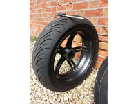 Triumph Speed Triple 1050 rear wheel with tyre, plus 2 other tyres, axles, single sided swingarm..