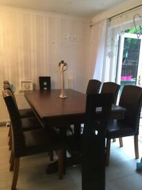 Solid wood dining table with 8 chairs immaculate condition