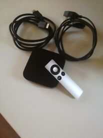 Apple TV with remote HDMI and power cable..