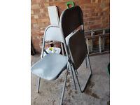 2 Metal folding chairs.