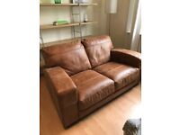 Immaculate two seater leather sofa, never used.