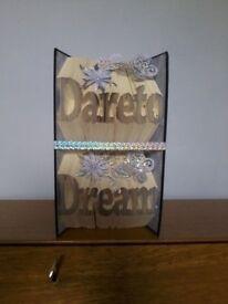 """""""Dare to Dream"""" book sculpture."""