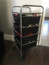 Mini storage unit on wheels