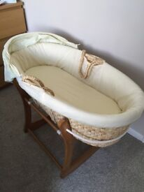 Moses basket and rocking stand. Comes with mattress and 5 lemon sheets.