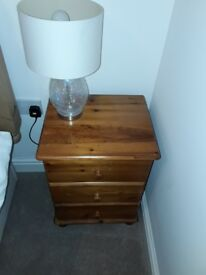 Solid pine 3 draw bedside table.