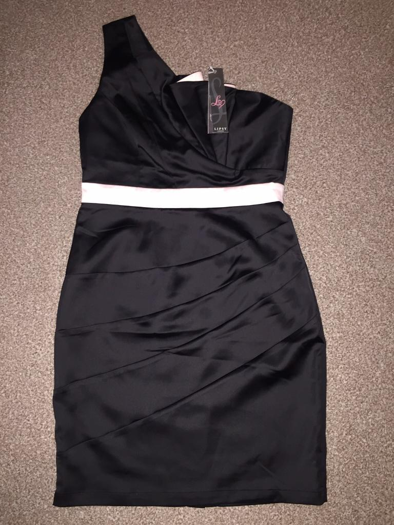Lipsy dressin Belfast City Centre, BelfastGumtree - Brand new lipsy dress size 12, never worn, labels still on, black satin one shoulder dress with pale pink fan detail, as new, from a smoke and pet free home, Bangor area £15