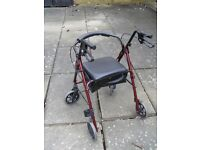 Rollator - with seat and carrier bag.