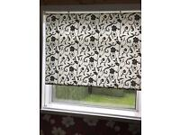 Black and white patterned roller blind