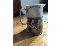 Large jug with dogs