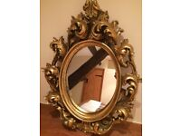 Gold Ornate Oval Mirror in the style of Rococo Design