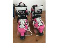 Adjustable size roller skates size 12-3. Pink, good condition second hand.