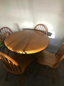 Wooden dining room table with 4 chairs